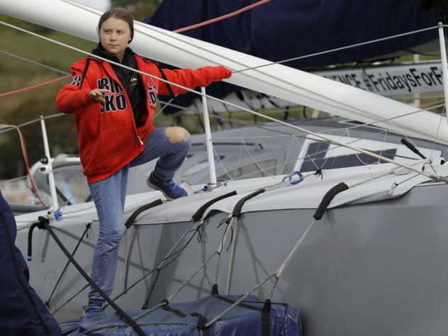 Greta Thunberg climbs onto the boat Malizia as she prepares to set off for the U.S. from Plymouth, England. The 16-year-old activist will attend a United Nations climate summit.