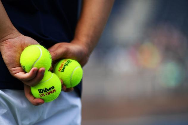 """For the ballpersons of the U.S. Open tennis tournament, footwork and athletic ability are important, but """"good focus"""" is the first priority, says manager Tina Taps."""
