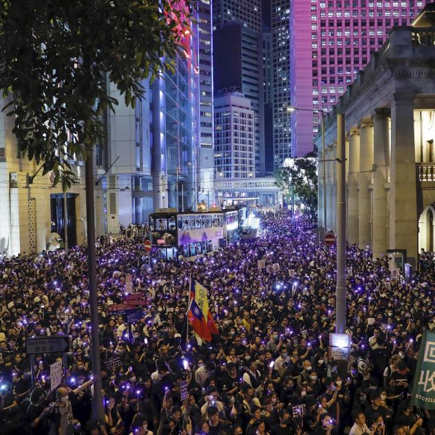 People light up their smartphones as they take part in a rally in Hong Kong's financial district on Wednesday.
