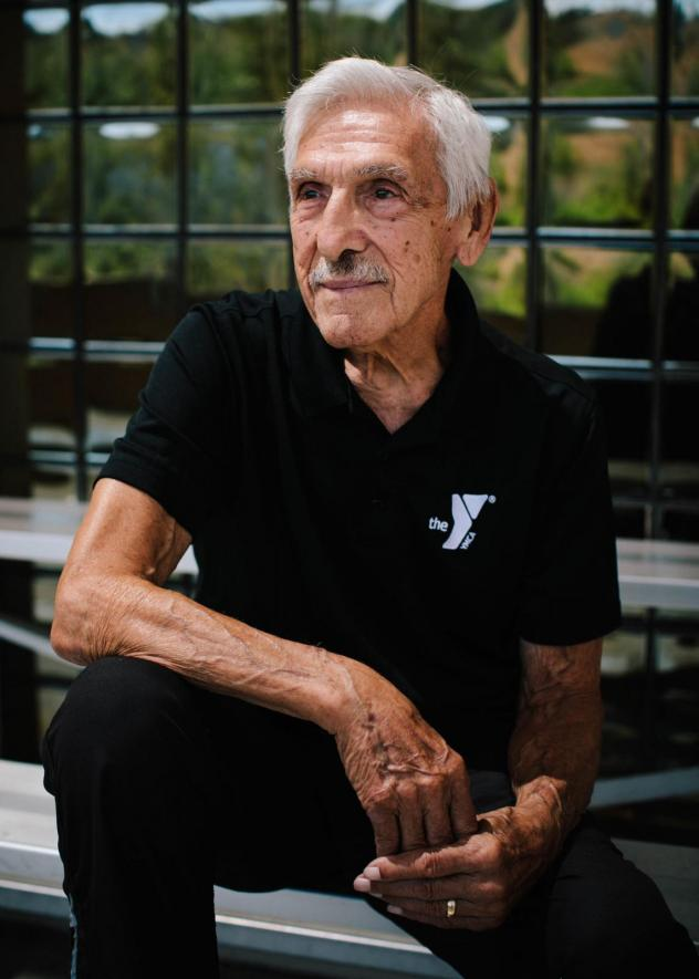 """Bob Orozco, 89, has been in fitness his entire adult life. He began working for the Laguna Niguel YMCA in 1984 and leads the Silver Sneakers Club, a free fitness program for Medicare beneficiaries. """"I probably will work until something stops me,"""" Orozco"""
