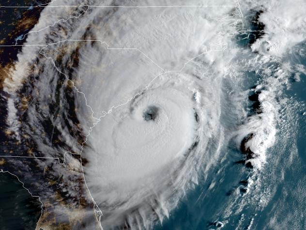 Hurricane Dorian is edging close to the Southeastern coast, bringing dangerous flooding to South Carolina. The storm is seen here at 8 a.m. ET Thursday.
