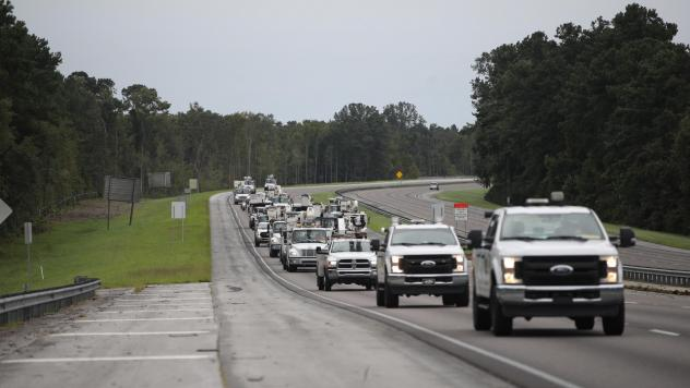 Utility trucks move in Monday as the outer bands of Hurricane Dorian approach in Charleston, S.C. Residents in Charleston and many other coastal areas are under an evacuation order.