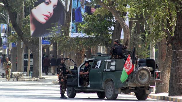 Many Afghans approve of President Trump's decision to quash a potential deal with the Taliban. Here, security forces guard a street in Kabul last week after a suicide car bombing rocked the capital's diplomatic enclave.