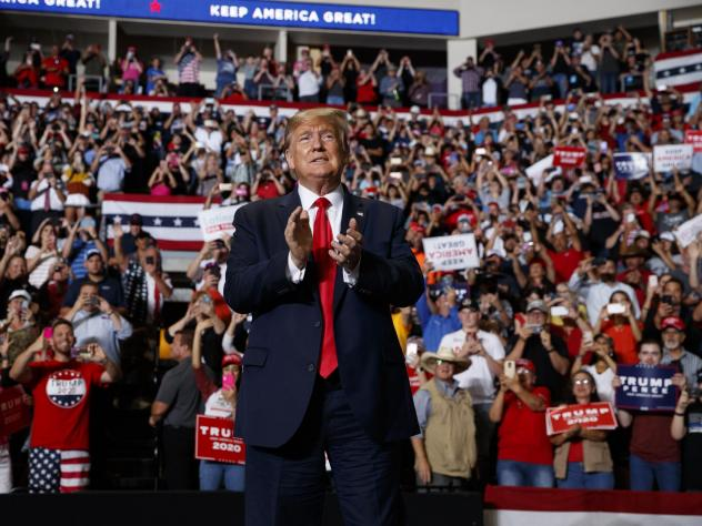 President Donald Trump arrives to speak at a campaign rally Monday night in Rio Rancho, N.M.