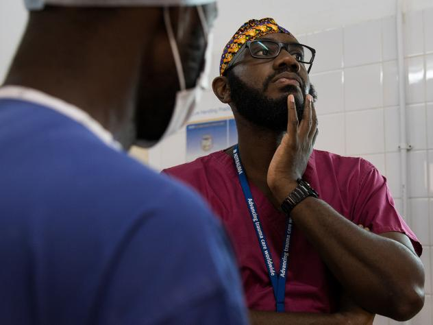 Orthopedic surgeon Kebba Marenah and his team get ready to perform knee surgery on a 14-year-old at the Edward Francis Small Teaching Hospital in Banjul, the capital of Gambia. The country struggles with a lack of access to sufficient pain medications.