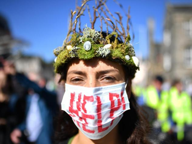 The Global Climate Strike drew scores of protesters around the world Friday, as young people answered a call from activist Greta Thunberg to demand action on climate change. Here, a protester attends a rally in Edinburgh, Scotland.