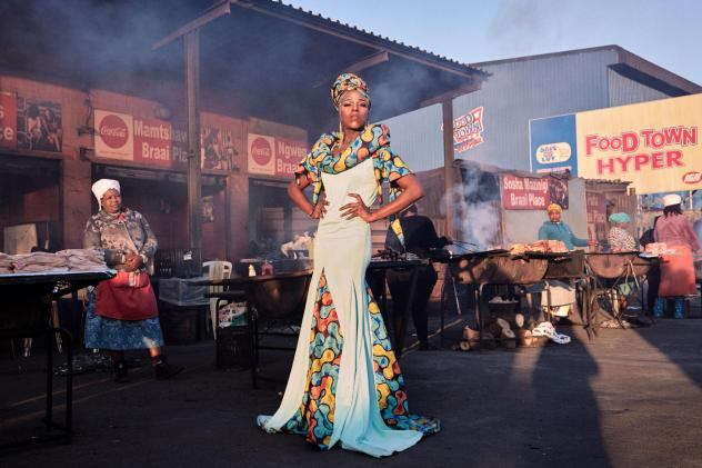 """Belinda Qaqamba Ka-Fassie poses at a community space where women cook and sell meat. She started drag as an escape from oppression she felt at Stellenbosch University for being """"black, Xhosa, poor, queer and effeminate."""" """"It is through pageantry and perf"""