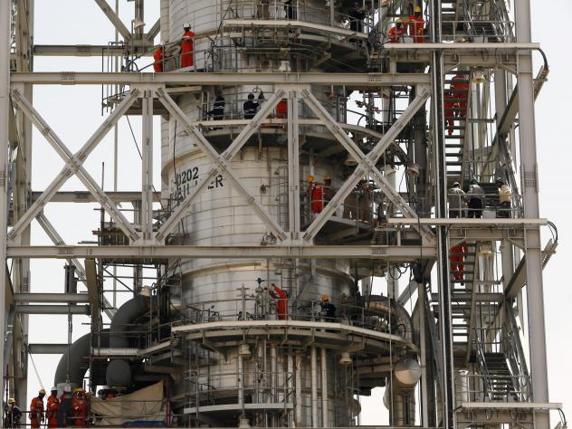 Workers fix the damage in the Aramco's Khurais oil field in  Saudi Arabia, Sept. 20, 2019, after it was hit during Sept. 14 attack the U.S. alleges Iran carried out.