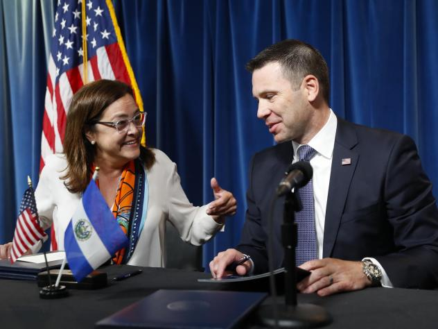 Acting Secretary of Homeland Security Kevin K. McAleenan, right, with Alexandra Hill Tinoco, left, minister of Foreign Affairs for El Salvador, after signing an asylum agreement in Washington, D.C.