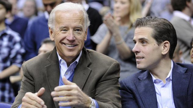 Then-Vice President Joe Biden and his son Hunter Biden attend a basketball game in Washington in 2010. Joe Biden frequently dealt with the Ukrainian government and pressed the government to deal with corruption issues. At the same time, Hunter Biden was