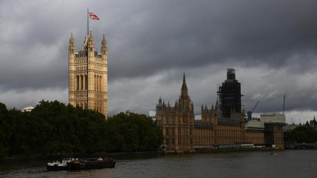 """The Palace of Westminster, meeting place of the houses of British Parliament, looms over the Thames in London. Parliament reconvened Wednesday after the U.K. Supreme Court ruled its suspension by Prime Minister Boris Johnson """"unlawful."""""""