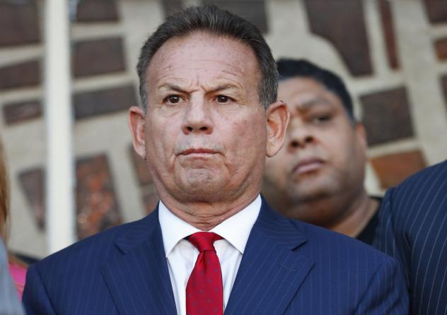 Scott Israel listens to comments by his attorney at a news conference in January 2019. Florida Gov. Ron DeSantis suspended Israel over his handling of last year's massacre at Marjory Stoneman Douglas High School. Florida Senate special master Dudley Good