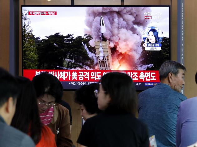 People at the Seoul Railway Station watch a newscast showing a file image of a North Korean missile launch. North Korea on Wednesday fired projectiles toward its eastern sea, South Korea's military said, in an apparent display of its expanding military c