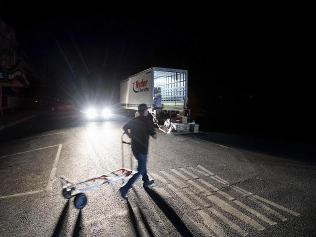 Armando Espinoza delivers paper products to a cafe in downtown Sonoma, Calif., where power is turned off, on Wednesday. Pacific Gas & Electric has cut power to more than half a million customers in Northern California hoping to prevent wildfires during d