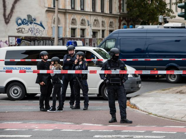 Police block access to a street near the scene of an attack that left two people dead on Wednesday in Halle, Germany. Initial reports indicate a man fired shots outside a synagogue and a kebab shop in the eastern German city.