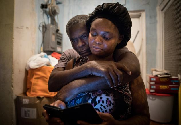 A month after Hurricane Dorian devastated the Bahamas, Sherrine Petit Homme LaFrance gets a hug from husband Ferrier Petit Homme. The storm destroyed their home on Grand Abaco Island. They are now living with China Laguerre in Nassau.