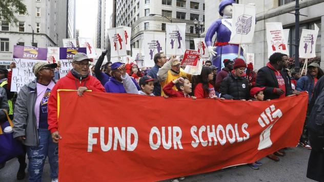 Teachers, staff and their supporters marched through downtown Chicago on Monday to show support for the teachers union.
