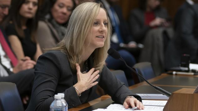 Kathleen Kraninger, director of the Consumer Financial Protection Bureau, testifies before the House Financial Services Committee on March 7. On Thursday, she faced questions from senators about problems with a student loan program for public service wor