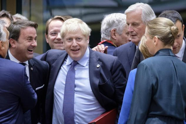Luxembourg's Prime Minister Xavier Bettel (from left), U.K. Prime Minister Boris Johnson and the European Commission's chief Brexit negotiator, Michel Barnier, at the start of an EU summit on Thursday in Brussels. EU and British negotiators came to an ag