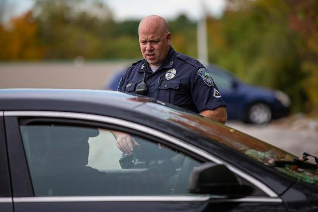 Officer Brian Cregg checks in with a man who says he is homeless and living in his car in Concord, N.H. In Concord, as in many parts of the Northeast, widespread use of meth is new, police say, and is changing how they approach interactions with people w