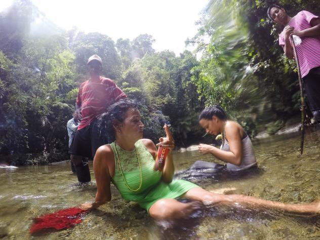 Marta Amaro and Liset Barrios take a minute to rest after crossing a river in the Darien Gap, the untamed jungle that engulfs the Colombia-Panama border. Photographer Lisette Poole went with them to document their journey north.