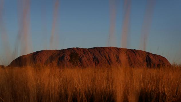 Uluru, seen at sunset from a designated viewing area earlier this year in Australia's Uluru-Kata Tjuta National Park. The sandstone monolith will be closed to climbers permanently Saturday, in a blow to tourists' aspirations and a boon to the aboriginal