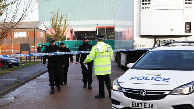 Essex police officers at the scene where 39 bodies were found in the back of a truck on October 24.
