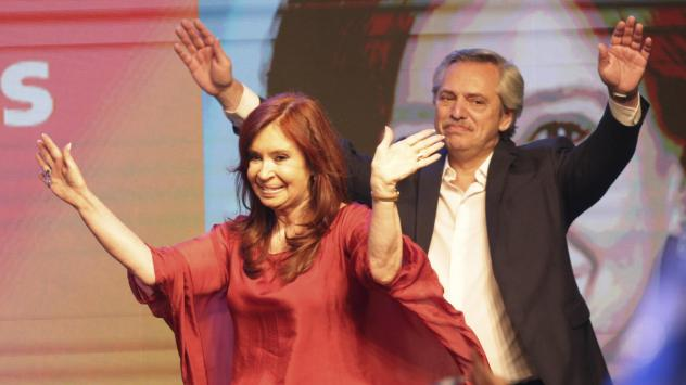 Peronist presidential candidate Alberto Fernández and running mate, former President Cristina Fernández de Kirchner, wave to supporters after incumbent President Mauricio Macri conceded defeat at the end of election day in Buenos Aires, Argentina, Sund