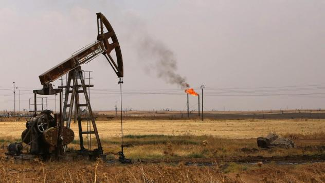 Oil well pumps are seen in Syria's northeastern Hasakeh province in 2015. President Trump is renewing his push for U.S. control of Syrian oil.