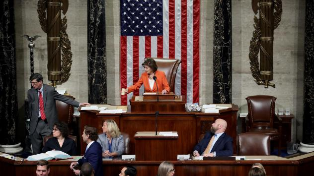 Speaker of the House Nancy Pelosi gavels the close of the vote by the U.S. House of Representatives on a resolution formalizing the impeachment inquiry into President Trump.