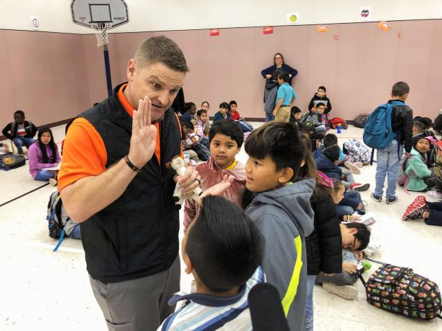 Principal T.J. Funderburg welcomes his mostly immigrant students during morning assembly at Cactus Elementary School.