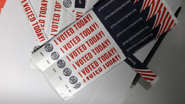 """Despite unanswered questions about security and transparency, mobile voting pilots aimed at overseas and military voters move forward in a number of states. Above, wristbands noting """"I Voted Today!"""" are available at Sojourn Community Church in Louisville"""