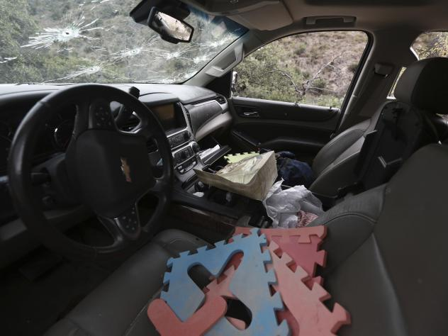 Foam puzzle pieces sit on the driver's seat of the bullet-riddled Suburban that had been driven by a member of the LeBaron family.