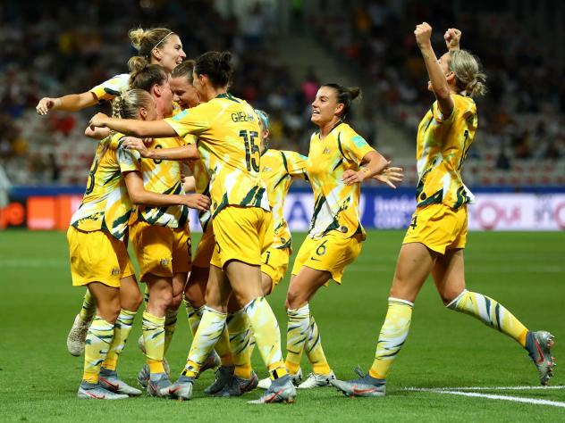 Australia celebrates a goal during its knockout round match against Norway during the Women's World Cup in France in June. Football Federation Australia announced a new deal on Wednesday to improve pay and conditions for the women's team, known as the Ma