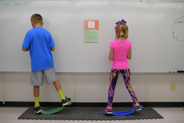 """Two fourth-graders rock side to side while doing math equations at Charles Pinckney Elementary School's """"Brain Room"""" in Charleston, S.C., in 2015."""