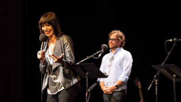 Ophira Eisenberg performs on stage with Jonathan Coulton on <em>Ask Me Another</em> at the Majestic Theatre in Dallas, Texas.