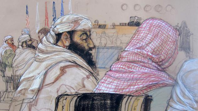 In this Pentagon-approved courtroom sketch, defendant Ramzi Binalshibh (center) attends his pretrial hearing along with other defendants at the U.S. military court in Guantánamo Bay, Cuba, on April 14, 2014. Also depicted are Mustafa al-Hawsawi (from ri