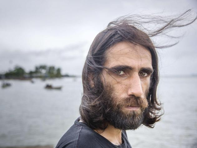 Behrouz Boochani, seen last year at the Australian detention center on Manus Island, Papua New Guinea, where the Kurdish-Iranian asylum-seeker spent years seeking his freedom. On Thursday, the prize-winning author touched down in New Zealand on his way t