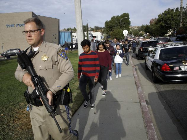 Students are escorted out of Saugus High School, where authorities say a student killed two teenagers and wounded three others in a shooting in Santa Clarita, Calif., Thursday.