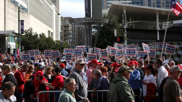 "Attendees hold ""We Vape, We Vote"" signs ahead of a Trump rally last month in Dallas. The politics surrounding vaping and industry pushback against regulation appear to have derailed the Trump administration's plan to ban the sales of many vaping products"
