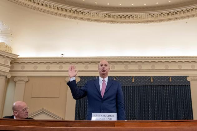 U.S. Ambassador to the European Union Gordon Sondland takes the oath ahead of his House Intelligence Committee hearing on Wednesday as part of the impeachment inquiry into President Trump.