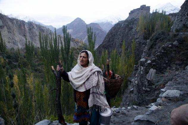 Shamim Banno, 55, walks up the Harchi Valley after she finished milking her cow. Farmers in the Harchi Valley in Pakistan's highlands have enjoyed a close relationship with their glacier that snakes between two mountain peaks.