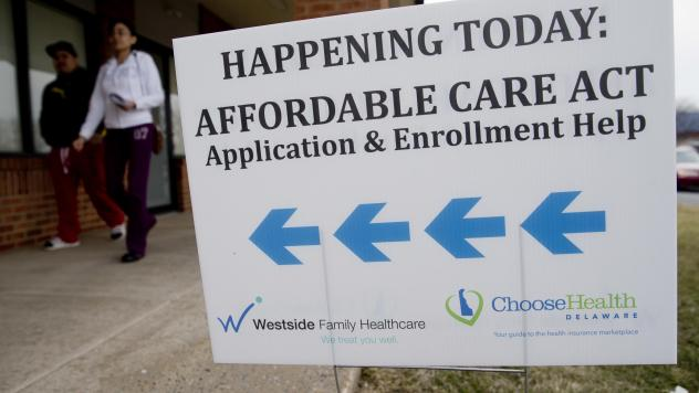 Enrollment help was plentiful for insurance sign-ups in the early years of the Affordable Care Act, such as at this clinic in Bear, Del., in 2014. Though the Trump administration has since slashed the outreach budget, about 930,000 people have signed up