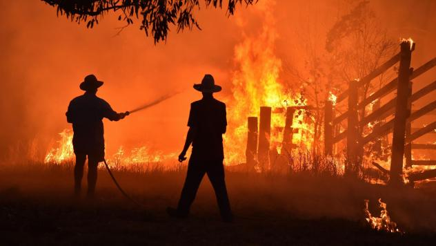 Residents defend a property from a bushfire earlier this month in Taree, north of Sydney.