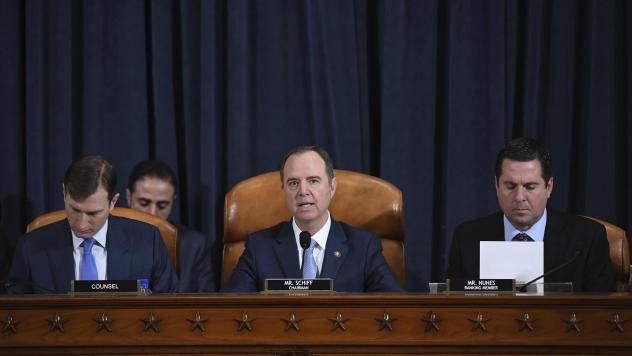 House Intelligence Committee Chairman Adam Schiff, D-Calif. (center); ranking member Rep. Devin Nunes of California (right); and committee counsel Daniel Goldman hold an impeachment inquiry hearing on Nov. 21. Schiff has released the panel's report on th