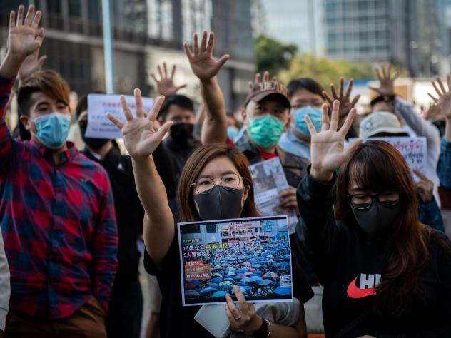 People gather in support of pro-democracy protesters during a lunch break rally in the Kwun Tong area in Hong Kong on Wednesday. Hong Kong has been battered by months of mass rallies and violent clashes between police and protesters who are demanding dir