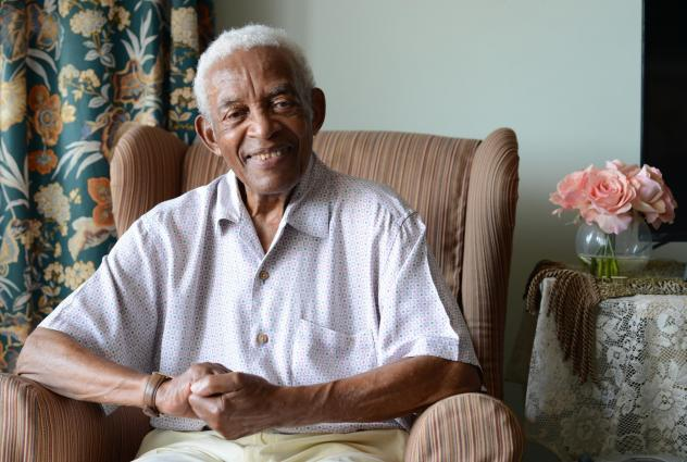 "Irving Burgie at his home in Queens in 2017. Burgie, who rewrote the lyrics to the traditional Jamaican song ""Day-O,"" died Friday at the age of 95."