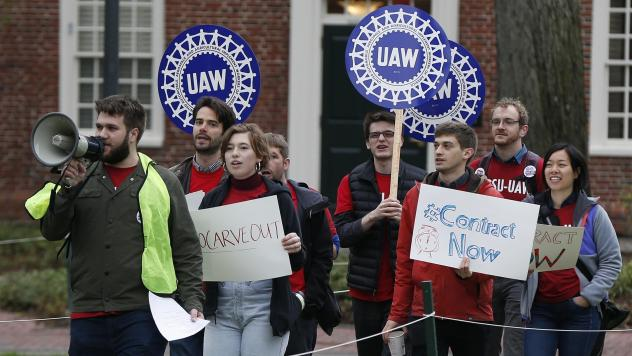 Union members protest at Harvard University in May over an increasing number of harassment and discrimination cases. The union began an indefinite strike Tuesday, with one of its key proposals aimed at strengthening protections against harassment and dis