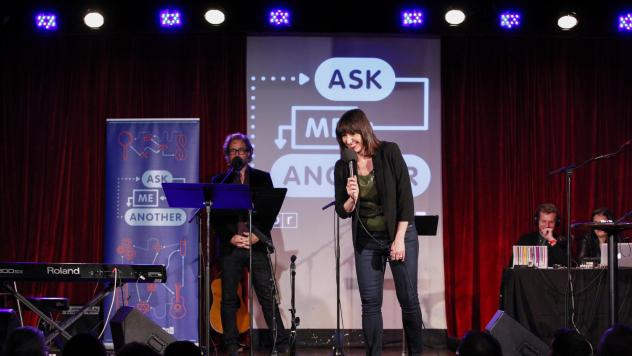 Ophira Eisenberg performs on stage alongside Jonathan Coulton on <em>Ask Me Another</em> at the Bell House in Brooklyn, New York.