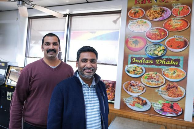 Co-owners Vamsi Yaramaka (left) and Raj Alturu stand inside Eat Spice on Oct. 24, in the truck stop on Route 534 off I-80 in White Haven, Pa. The restaurant caters to members of the Sikh community. For them, Indian and Mediterranean dishes can be hard to